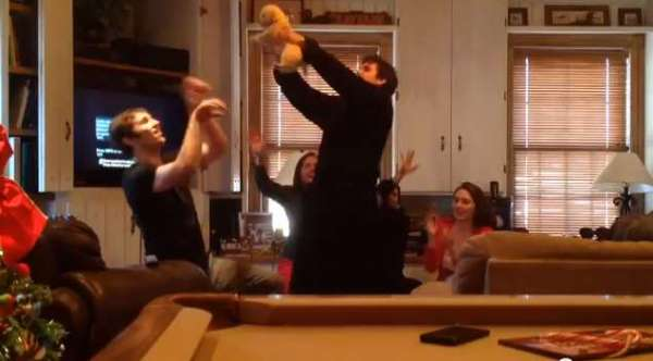 Kids present puppy to parents Lion King style