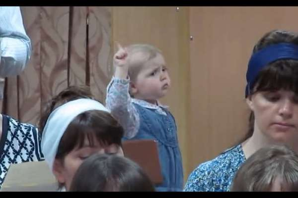 Passionate Baby Girl Conducts a Church Choir