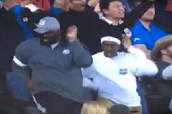 Father and Son Dancing 'Happy' at This Basketball Game
