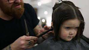 girl gives up hair for others