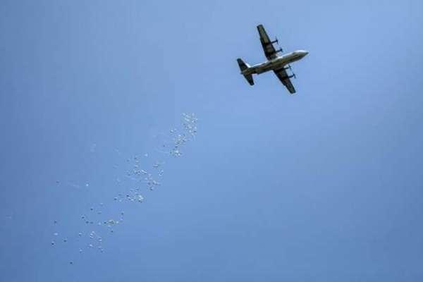 red cross drops humanitarian aid