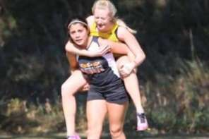 Cross Country Runner Carries Injured Competitor Across The Finish Line