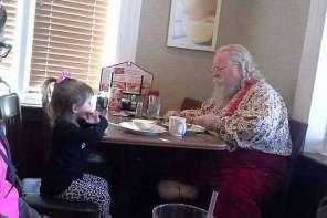 Little Girl Meets Santa At A Diner