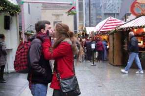 A Guy With Mistletoe Kissing Contraption Gets Kissed