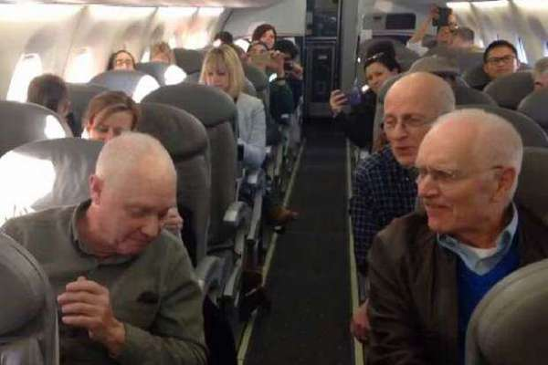 barbershop Quartet sings on a plane