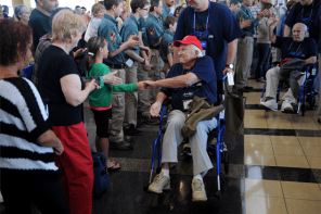 World War 2 Veterans Return From A Flight To A Standing Ovation
