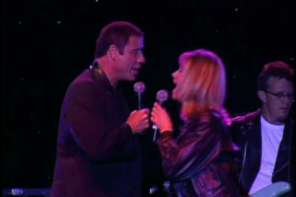 John Travolta And Olivia Newton John Reunite On Stage To Perform Song From Grease