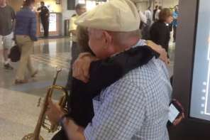"Man Serenades Wife's Return With ""What A Wonderful World"""