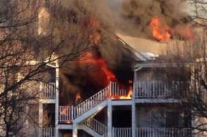Officers Catch 9 year old Girl Jumping From Balcony Of Burning Condo