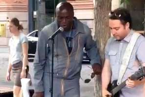 "Seal Joins Street Musician To Sing ""Stand By Me"""