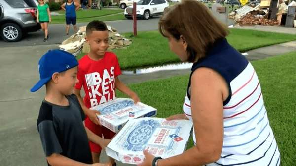 boy delivers pizzas to flood victims