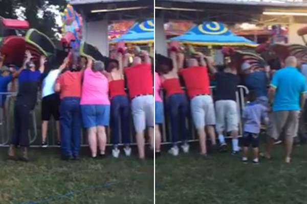 bystanders hold up rollercoaster
