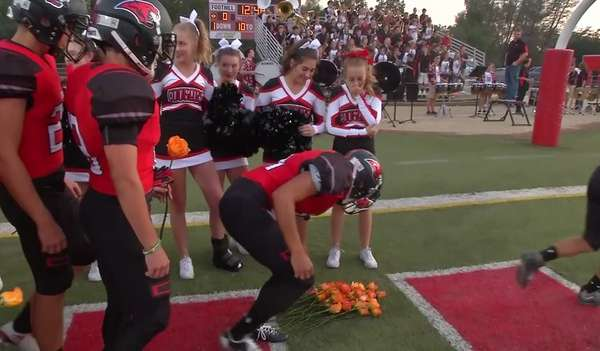 cheerleader-gets-support-from-football-team
