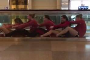 Female Swim Team Entertain Themselves In Airport