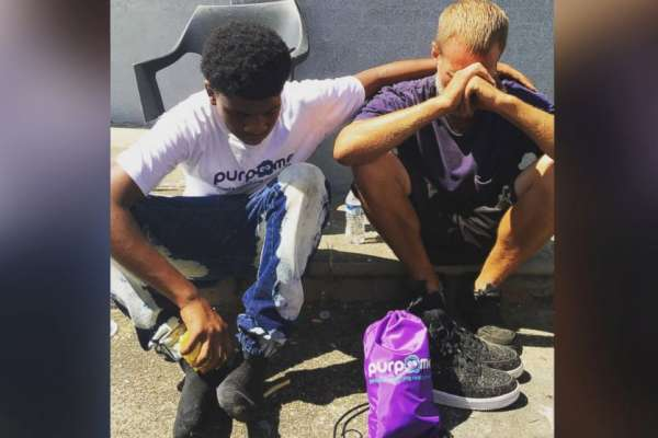 teen-gives-shoes
