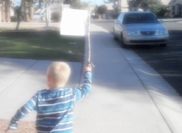 One Child Tries To Remind People About The Blessings Of Living In America By Holding Up A Banner Of The Constitution