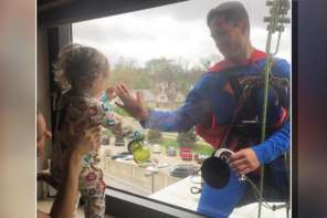 Superman Window Washer Visits Tiny Cancer Patient