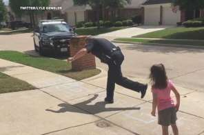 Texas Police Officer Plays Hopscotch With Little Girl On His Break