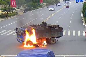 Samaritans Rescue Motorcyclist After Crashing Into Dump Truck And Bursting Into Flames