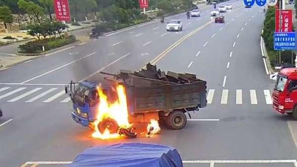 chinese motorocyclist crashes into dump truck