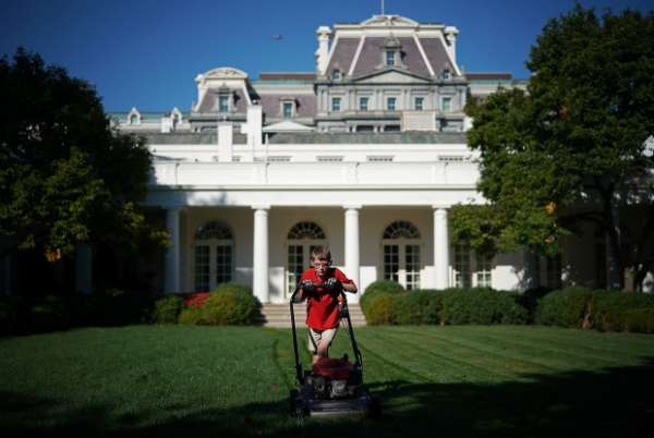 """WASHINGTON, DC - SEPTEMBER 15:   11-year-old Frank """"FX"""" Giaccio mows the grass in the Rose Garden of the White House September 15, 2017 in Washington, DC. Giaccio, from Falls Church, Virginia, who runs a business called FX Mowing, wrote a letter to Trump expressing admiration for Trump's business background and offered to mow the White House grass.  (Photo by Win McNamee/Getty Images)"""