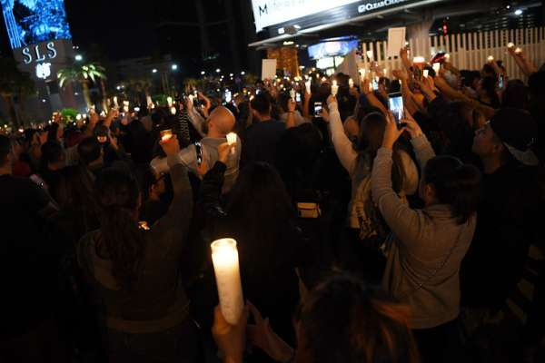 LAS VEGAS, NV - OCTOBER 02:  Hundreds of people gather for a vigil on the Las Vegas strip, for the victims of the Route 91 Harvest country music festival shootings on October 2, 2017 in Las Vegas, Nevada. Lone gunman Stephan Paddock, 64, of Mesquite, Nevada opened fire on festival attendees leaving at least 59 dead and over 500 injured before killing himself. The investigation is ongoing.  (Photo by Denise Truscello/Getty Images)