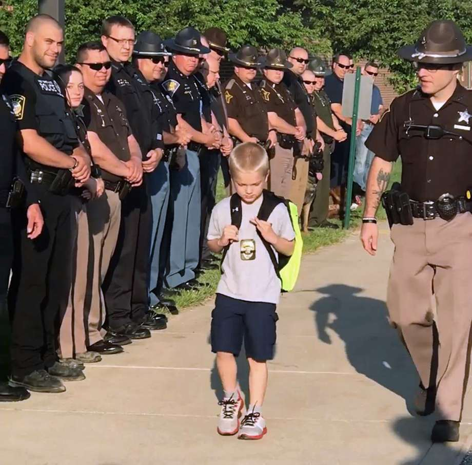 Son Of Slain Father Returns To School With 70 Officers As His Escort