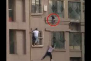 Good Samaritans Rescue Child Hanging From Balcony After Getting Stuck