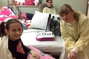 Taylor Swift Makes Surprise Visit To 8 Year Old Burn Survivor