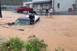 Human Chain Formed To Rescue Man In Truck During Flood