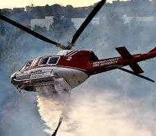 Helicopters Drop Fire Retardant Next To Freeway In California