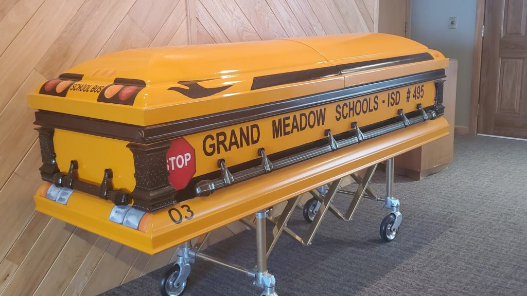 School Bus Driver Is Buried In School Bus Casket