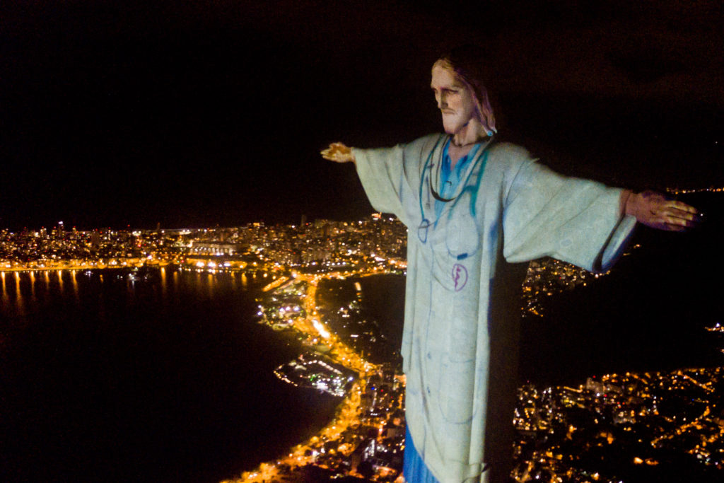 The Christ Statue In Rio Is Illuminated As Doctor During Covid Crisis